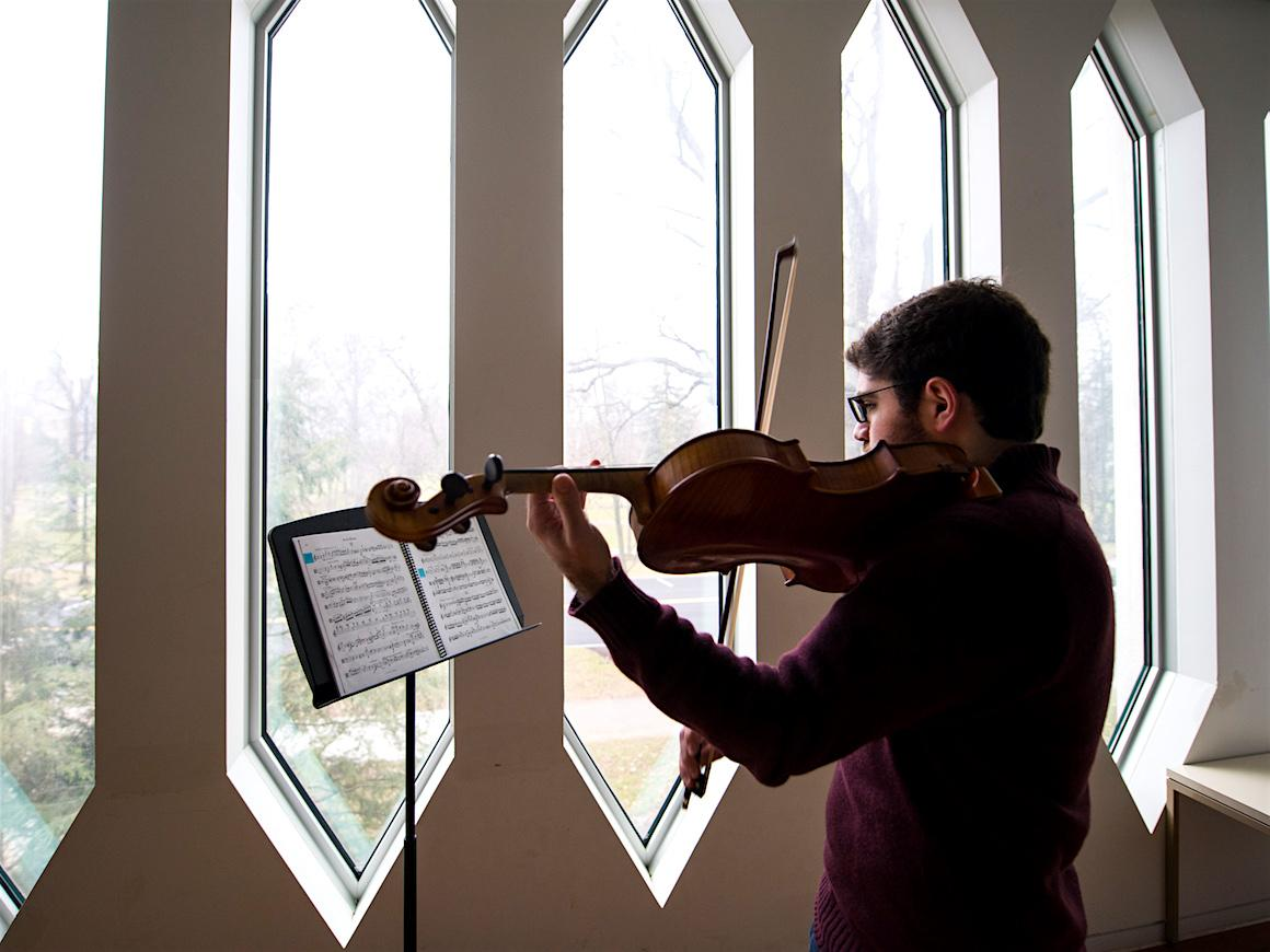 violist in practice room