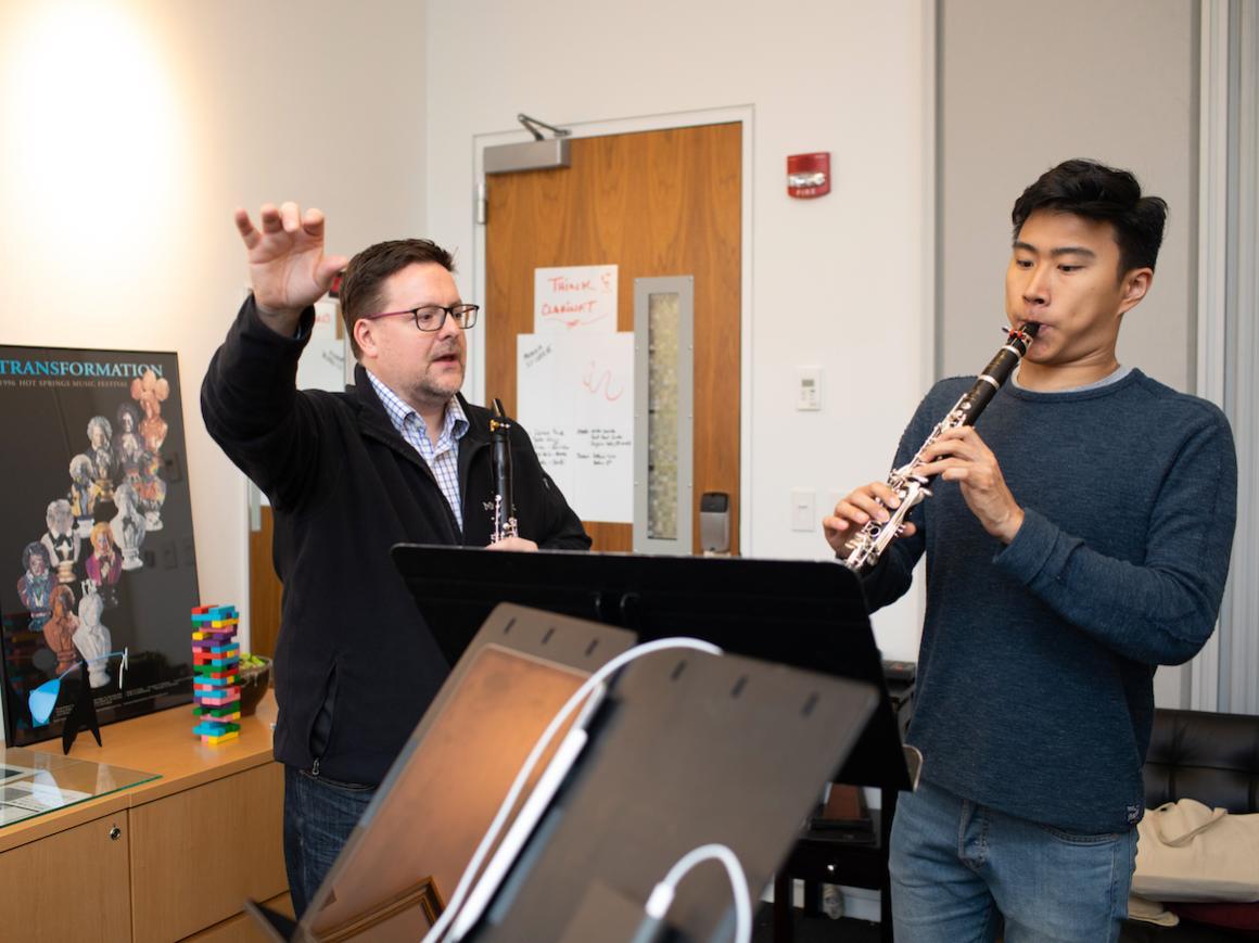 clarinet professor instructs student in his studio