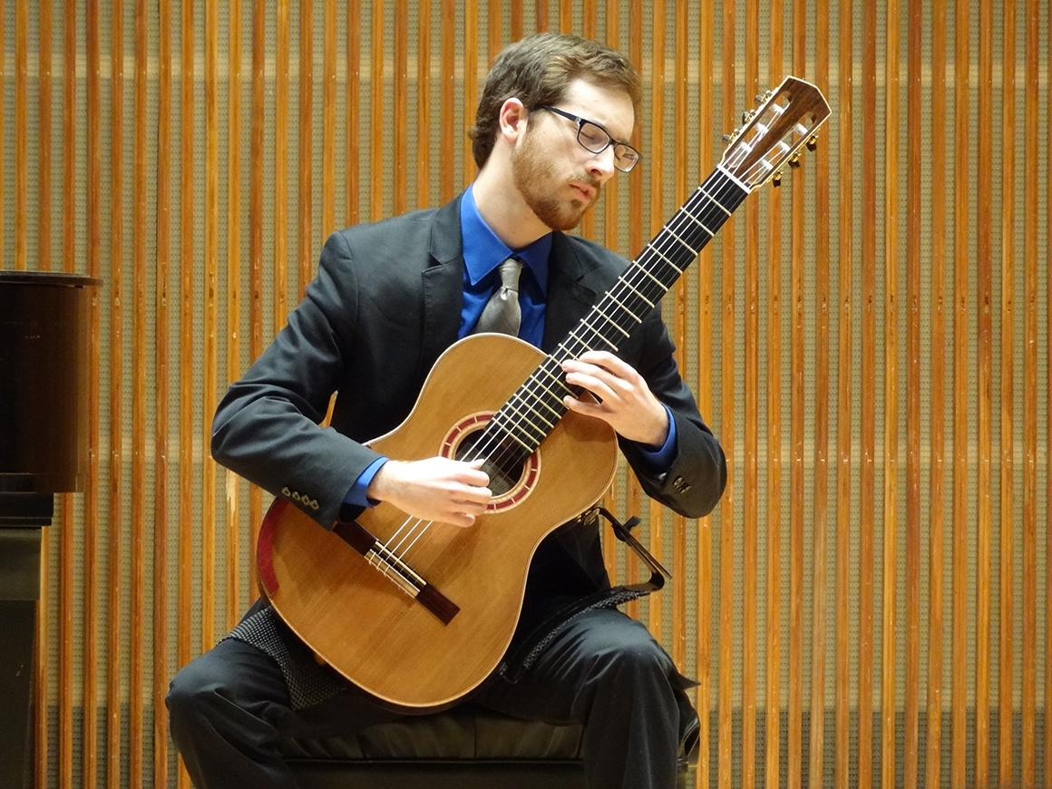 Student guitarist performing in Kulas Recital Hall.