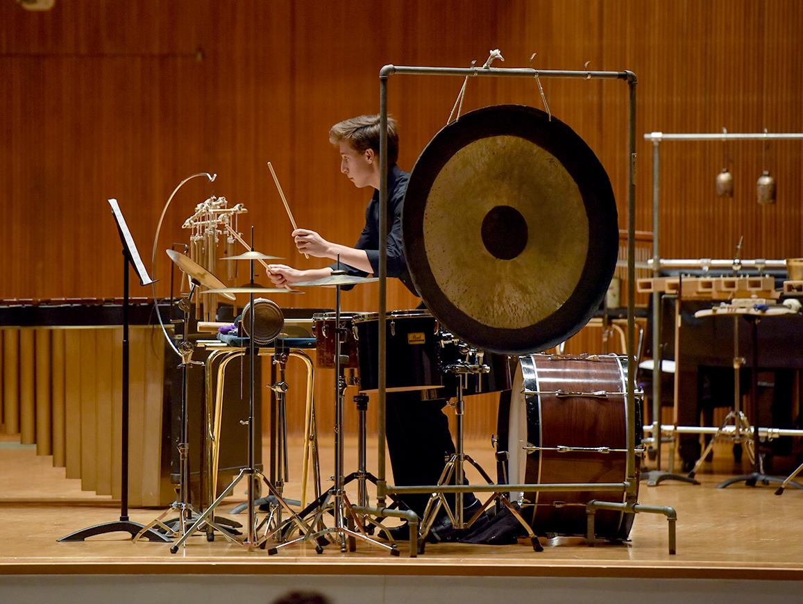 Percussion student performs with the Contemporary Music Ensemble in Warner Concert Hall.