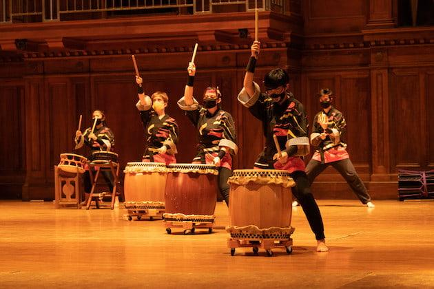 Taiko performers on stage in Finney Chapel.