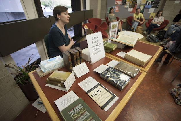 """Books on a table with a sign that reads """"A few banned books from special collections."""""""