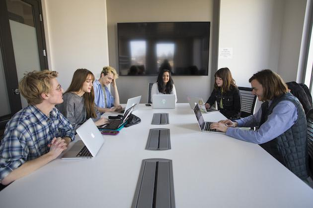 Students in a conference room.