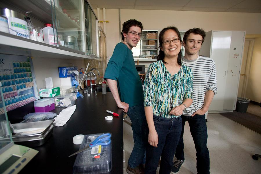 Professor and students enjoy a light moment in the lab.