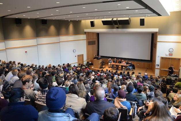 Dozens of students in a large lecture hall.
