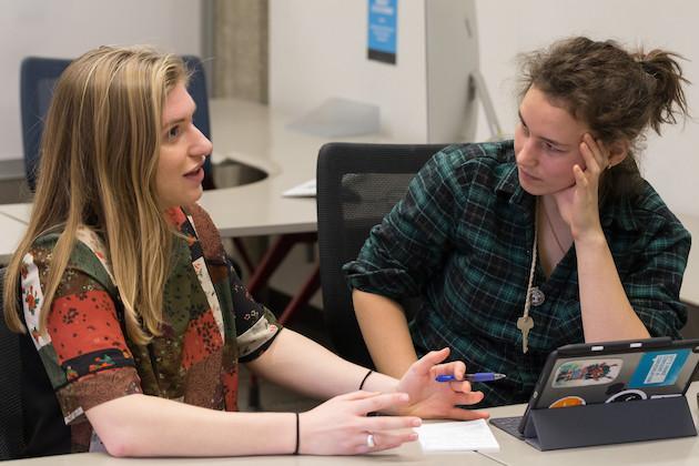 A writing associate helping a student.
