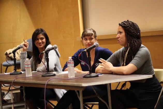 Three student panelists at a symposium.