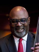jazz professor holding a bass
