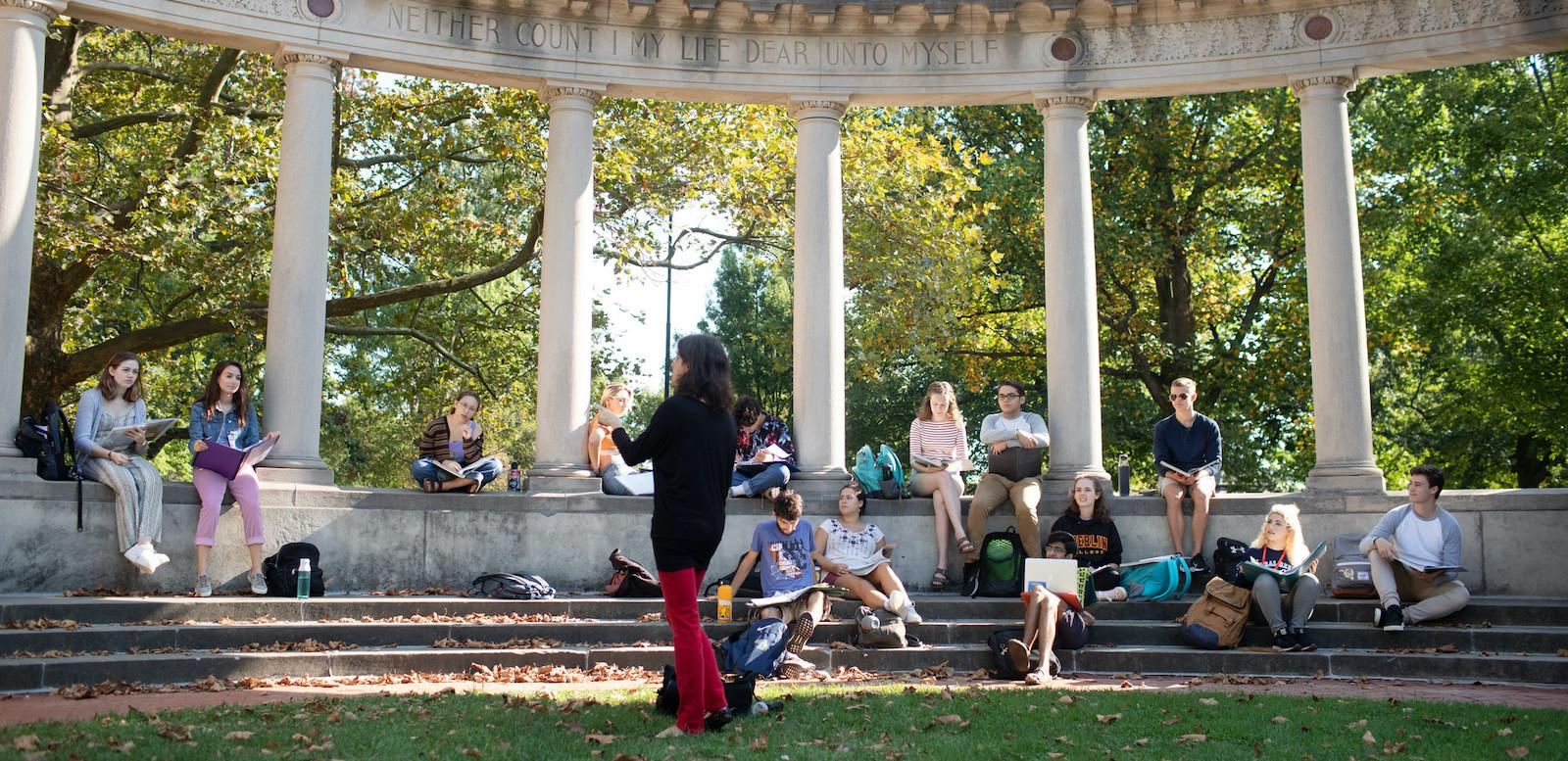 A class meets outside on campus.