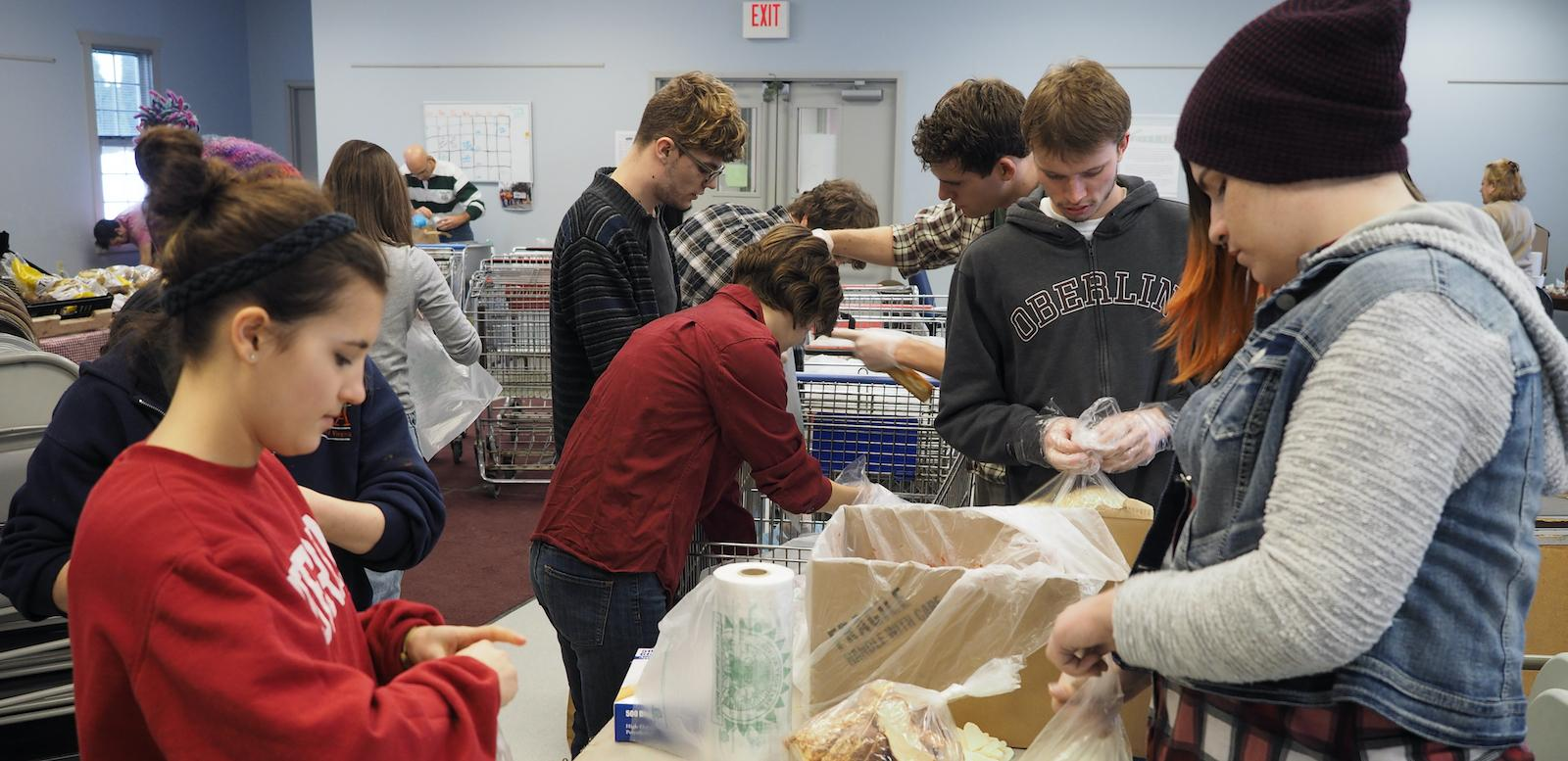 Students organizing food into boxes as part of MLK Day of Service
