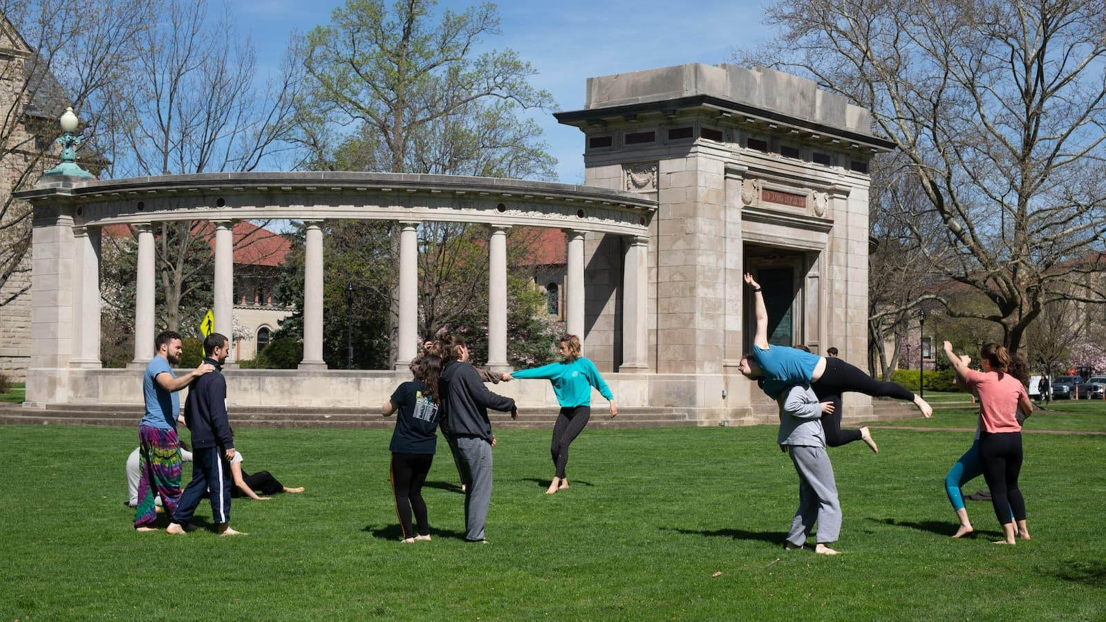 Dance students rehearsing on Tappan Square by the arch.