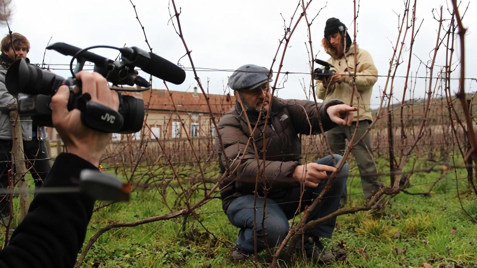 Students filming winemaker Vincent Laval in his vineyard.