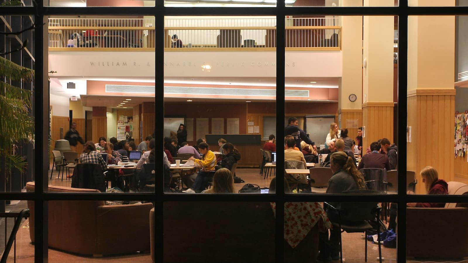 Students studying at night in Perlik Commons in the Science Center.