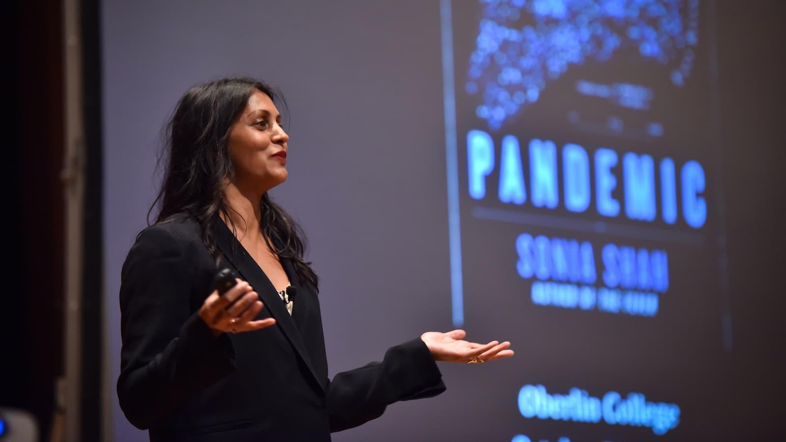 Sonia Shah giving a presentation.
