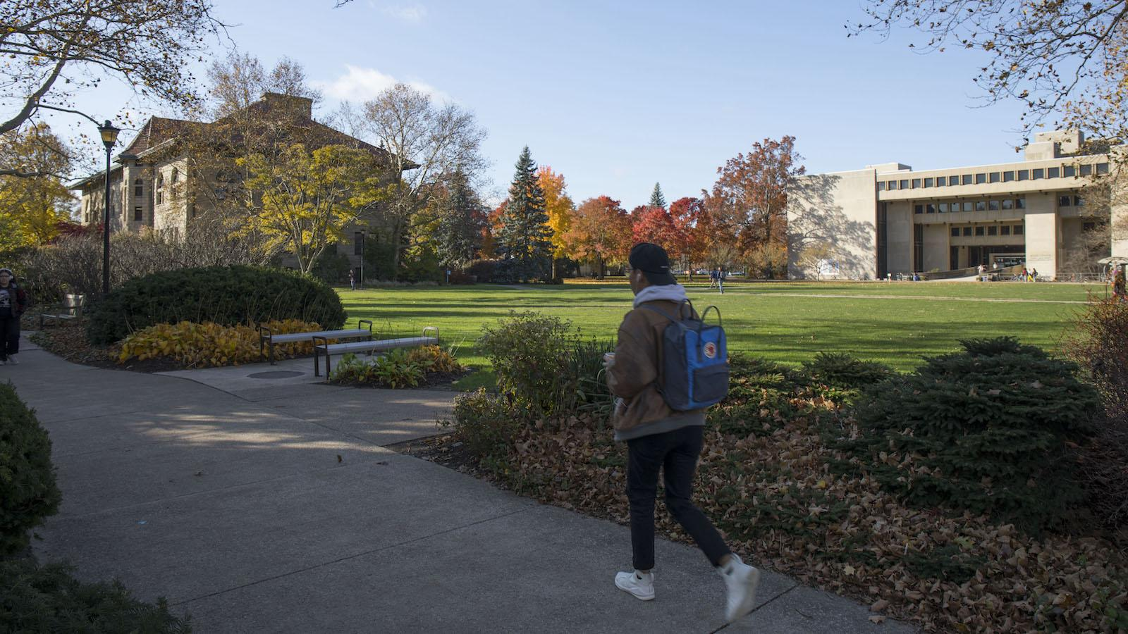 Students walking in Wilder Bowl on a sunny fall day.