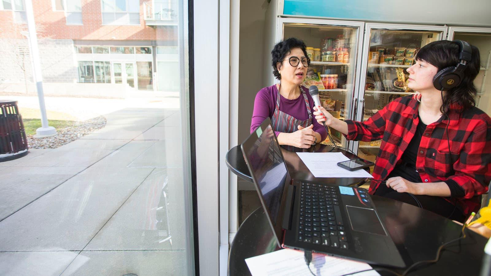 A student is interviewing the owner of a local store.