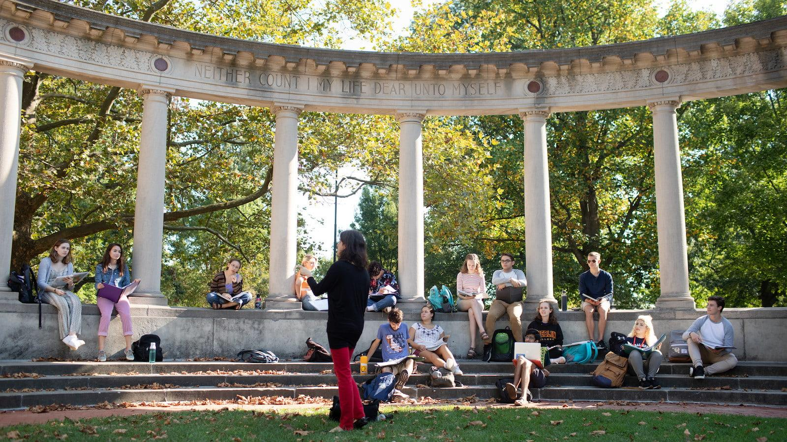 Ivana Di Siena teaching a class at the Memorial Arch on Tappan Square.