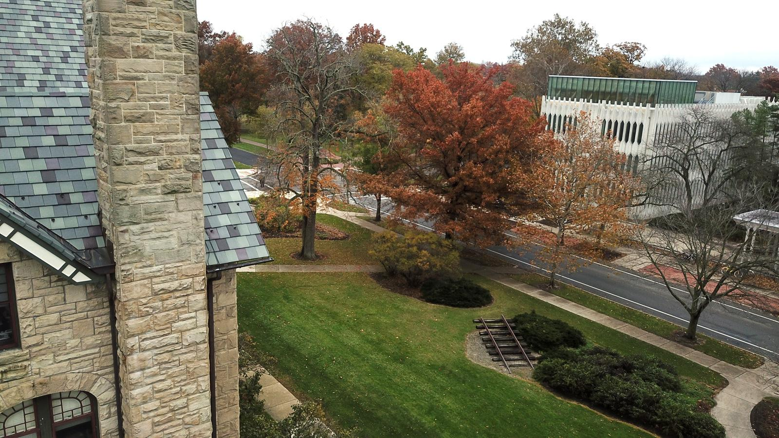 Aerial view of campus buildings and fall foliage.