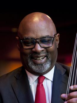 jazz professor holding a bass