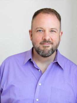 Greggor Mattson in purple button down shirt.