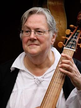 Photo of Mike Manderen holding a lute