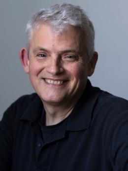 gray-haired man named Leonard Smith '80