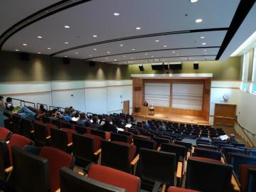 inside of a lecture hall in the evening