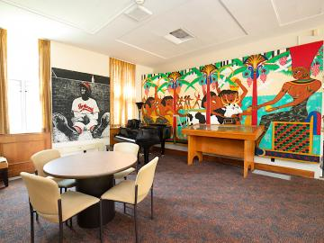 lounge area in residence hall with large photos and mural.