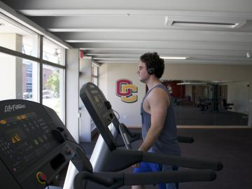 Student exercising in the Diane Yu Fitness Center