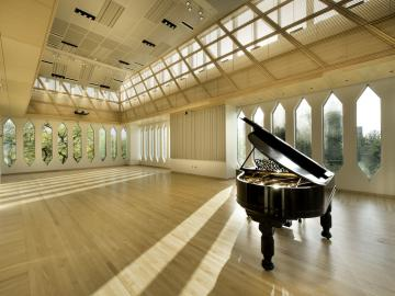 Grand piano in the sunlit David H. Stull Recital Hall