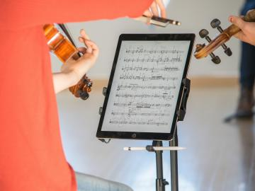 Student playing with iPad sheet music