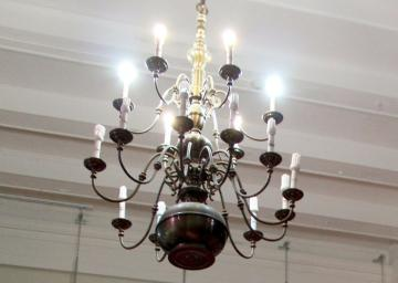 A large silver chandelier hanging from a white ceiling