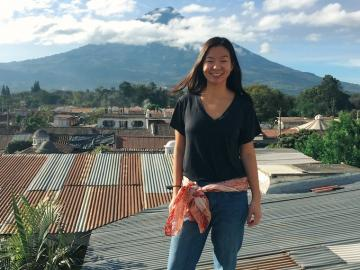 A student standing in front of a big mountain in Costa Rica