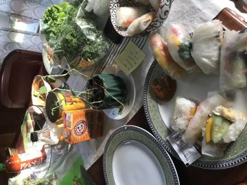 dining table covered in ingredients to make spring rolls
