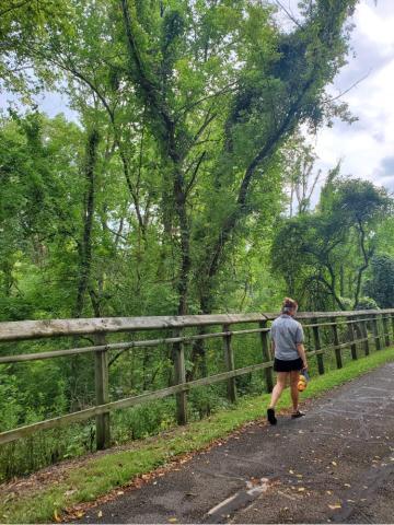 Ruth walking on the green Oberlin bike path