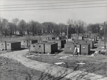 Gray-sided trailers on Lorain and Woodland streets.