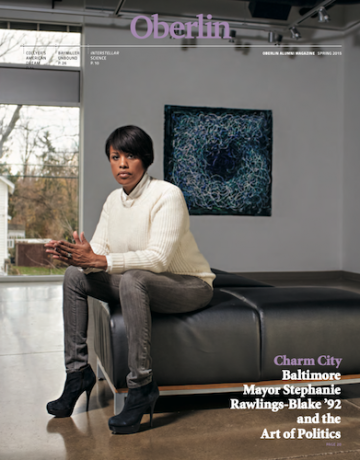 A magazine cover with a woman sitting on a bench in a museum.