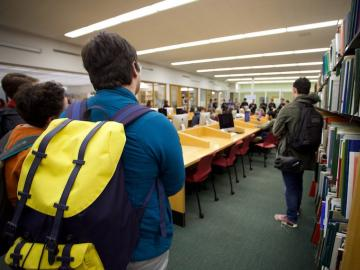 Students attend a small concert in a library.