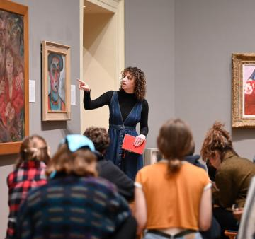A group of students tours the Oberlin Allen Memorial art museum.