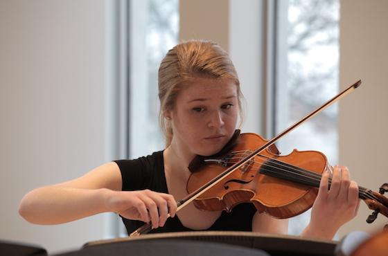 Student playing viola during a masterclass