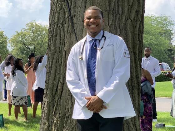 Portrait of first-year medical student Lawrence Hamilton in white lab coat.