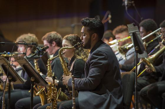 photo of student playing sax with jazz ensemble
