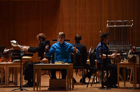 small ensemble on stage with handheld percussion instruments