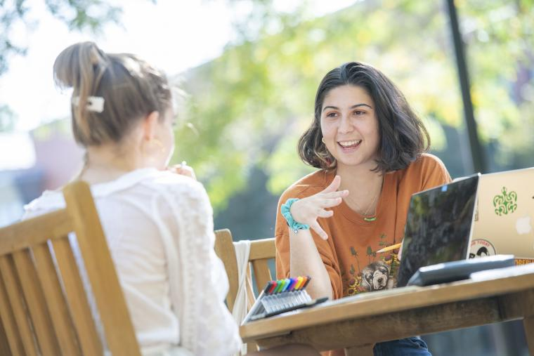 Two female students studying at a table.