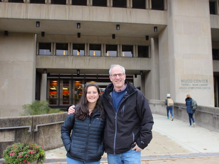 father and daughter standing in front of college library