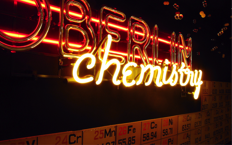 """Hand-made neon signage reading """"Oberlin Chemistry"""", which is on display outside of the department office."""