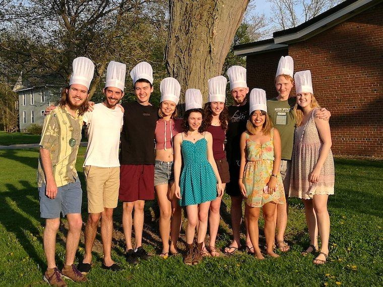 Groups of students wearing chef hats