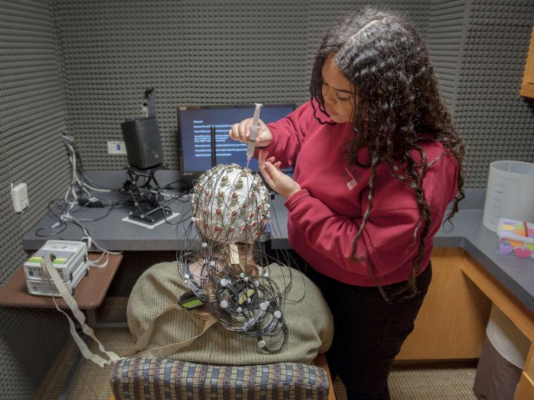 A female student conducts neuroscience research.