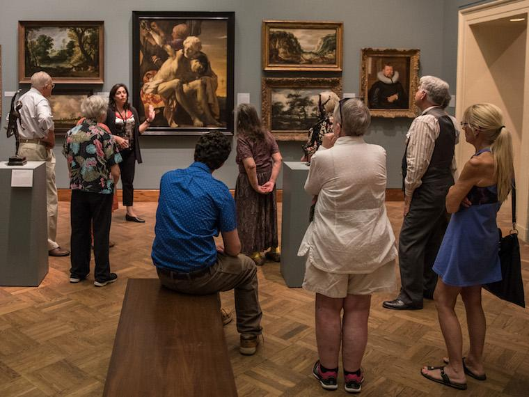 Photograph of people viewing art in an art museum.