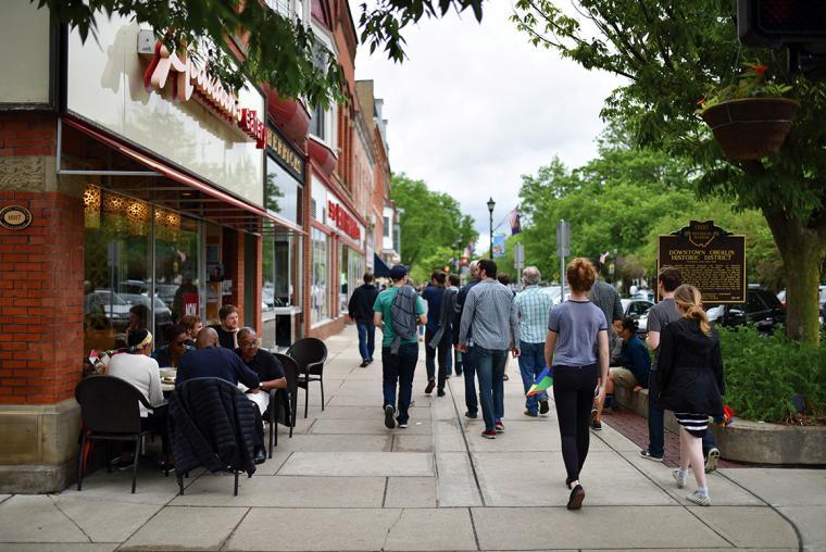 People stroll past Oberlin shops